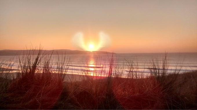 """""""Sonnenengel-Wolken"""" an der Küste von St. Peter's Point"""